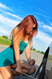 Girl changing broken tire Royalty Free Stock Images
