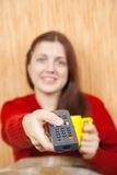 Girl changing channels with clicker at home Royalty Free Stock Images