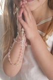 Girl and chaplet Stock Photo