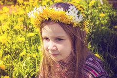 Girl with chaplet on head in the garden Stock Image