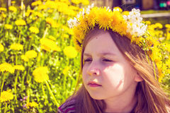 Girl with chaplet on head in the garden Stock Photography