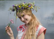 Girl in a chaplet from meadow flowers Royalty Free Stock Photos
