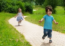 Girl chasing cute boy Stock Image