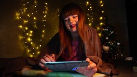 Pretty lady using on tablet christmas eve stock video