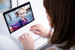 Girl chatting with friend over a video call royalty free stock photos