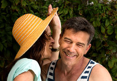 Girl chatting with a middle age man in a very funny conversation Stock Photo