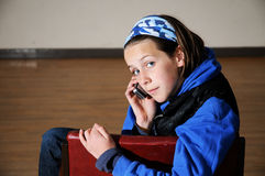 Girl chatting on mobile phone Royalty Free Stock Photos