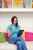 Girl chatting online with her friends Royalty Free Stock Images