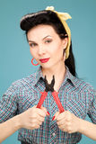 Girl in check shirt with pliers Royalty Free Stock Photo