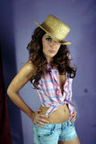 Girl with a checked open shirt and a straw hat 1 Stock Photo