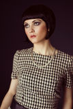Girl in checked retro dress Stock Photos