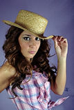 Girl with a checked shirt and a straw hat 1 Royalty Free Stock Photos