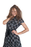 Girl in a checkered dress Royalty Free Stock Photos