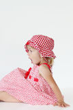 Girl in checkered dress. Baby girl in red checkered dress stock photos