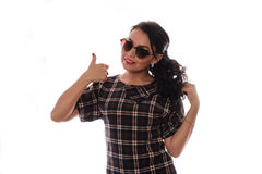 Girl in checkered dress with a raised finger Royalty Free Stock Image