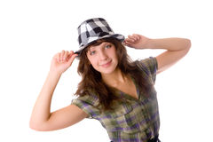 Girl in a checkered hat Royalty Free Stock Photos