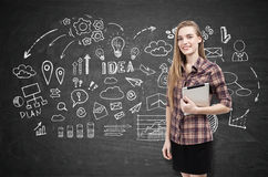 Girl in checkered shirt and business idea sketch Royalty Free Stock Images