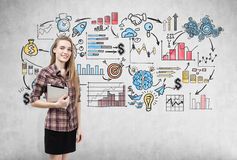 Girl in checkered shirt and business sketch Stock Photos