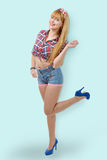Girl with checkered shirt and jean shorts Stock Photography
