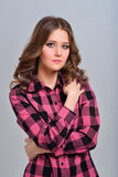Girl in checkered shirt posing Stock Photos