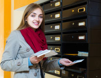 Girl checking correspondence at lobby Stock Photography