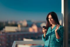 Girl checking her phone first thing in the morning Royalty Free Stock Images