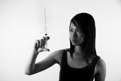 Girl checking injection needle Royalty Free Stock Photos