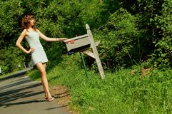 Girl Checking Mail. Pretty girl checking mail box for mail stock photos