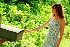 Girl Checking Mail. Pretty girl checking mail box for mail royalty free stock image