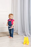 Girl checks cleaning cleanliness. Royalty Free Stock Photo