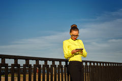 Girl checks email outdoors. Stock Photo