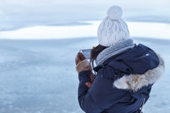 Girl Checks Photos at Winter Lake Stock Images