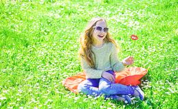 Girl on cheerful face spend leisure outdoors. Fashionista concept. Child posing with sunglasses cardboard smiling lips royalty free stock image