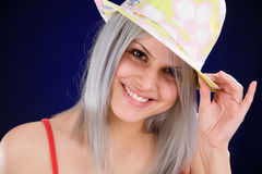 Girl with a cheerful hat Stock Image