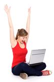 Girl cheering with laptop. Girl with laptop raising her arms in joy Stock Photography