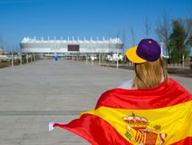 Girl cheerleader is heading to the football stadium with the Spanish flag royalty free stock images