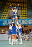 Girl from cheerleaders team Jam performs stunt Stock Photos