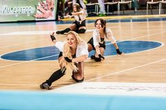 Girl Cheerleading appear on stage Match of the Euroleague Basketball FIBA womens Stock Image