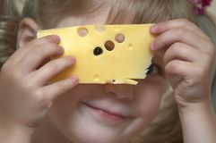 Girl with cheese. Girl holding a slice of cheese Stock Image