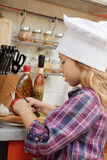 Girl in a chef cap Royalty Free Stock Photos