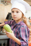 Girl in a chef cap h Royalty Free Stock Image