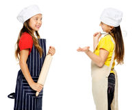 Girl chef cook. Child chef girl cooks friends playing kitchen together having fun isolated on white background Royalty Free Stock Photography