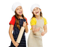 Girl chef cook. Child chef girl cooks friends playing kitchen together having fun isolated on white background Stock Images