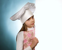 The girl with chef hat indicates  with billboards Stock Photo