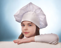 The girl with chef hat indicates isolated with billboards Stock Photography