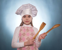 The girl with chef hat indicates isolated Stock Images