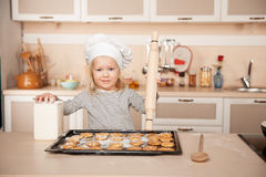 Girl with chef hat and rolling pin preparing Stock Images