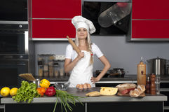 Girl chef in the kitchen Royalty Free Stock Photos