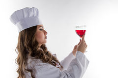 Girl chef with a large glass o Stock Photography