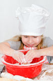 Girl in chef's hat Royalty Free Stock Photography